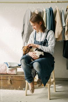 Tailor posing with dog by Milles Studio for Stocksy United