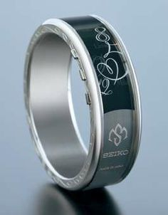 """seiko e-ink watch. either set in """"efficiency"""" mode to display time, or """"mystery"""" mode (as shown)."""