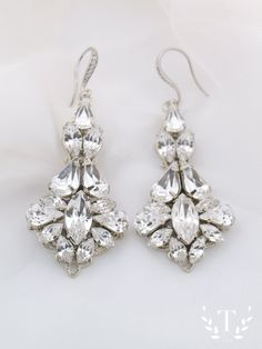 These are a stunning pair of statement bridal earrings, handmade with Swarovski crystal stones and available in silver or gold. - Statement Swarovski crystal earrings - Original design handmade to the