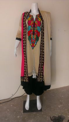 "4 Piece Party Wear Indian Crinkle Chiffon Suit Dupatta, Top, Kameez, & Trouser/Shalwar   Dupatta : Plain Light Camel with Red piping/lining/border  Top : Red top with matching border/piping/lining and full length and full front width embroidery   Inner: Plain Light Camel with Shameez, could be use as separate Kameez, length: 40"" Chest 20"" . Full Length Sleeves with red piping/lining/border  Trouser/Shalwar : Plain Red length: 39"" Fly 15"" and Sharara Style bottom of 17""  Price : USD $55.00/-"