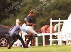 Princes Harry and Charles playing on the polo field.