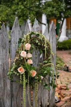 Love this floral wreath for a woodland or garden wedding   www.snippetandink.com