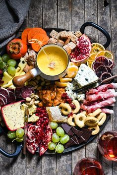 Winter Cheese Board with German Beer Cheese Fondue - Celebrate the season with this big, beautiful platter of cheese, charcuterie, bread, seasonal fruits and sweet treats. | http://foxeslovelemons.com