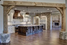 Love the wood beam/rock entry. Casa Patio, Pole Barn Homes, Cuisines Design, Rustic Kitchen, Kitchen Decor, House Goals, Beautiful Kitchens, My Dream Home, Great Rooms