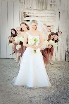I like this idea with the groom with the girls flowers behind him and the bride with the guys behind her
