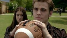 Stefan catching the football with his vampire skills.