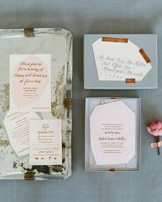 Modern Touches Elevate This Romantic Fall Wedding | Martha Stewart Weddings - The blush-colored save-the-dates were inspired by Madeline's wedding gown, and boasted rose gold foil-stamping. The invites were die-cut into geometric shapes, and wrapped in a while vellum with rose gold foil lines. Tied with silk ribbons and packaged inside gray boxes sealed with copper tape, each package had a calligraphed geometric shape on top to serve as address labels.