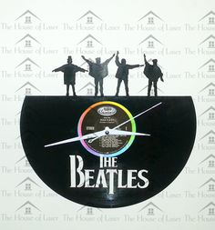 """#HELP! The #Beatles #HELP #LP #clock has been laser cut from an actual 12"""" LP Record. The silhouettes of The Fab Four are laser cut along the top of the LP and #TheBeatles logo at the bottom. The clock has white clock arms to contrast well against the dark vinyl, the arms are silent (doesn't tick) and has a quartz movement. Perfect gift for any Beatles fan especially with #Father's Day fast approaching! J&J"""