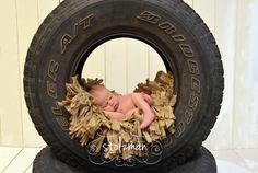 Newborn pose - newborn boy - newborn photography - tire pose