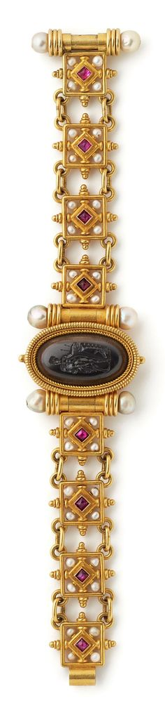 A Renaissance Revival gold, hardstone intaglio and gem-set Bracelet, Castellani, Rome, circa1875. Centred by an oval intaglio in black agate depicting Meleager with the head of the Calydonian boar. Signed with intertwined Cs to the reverse.