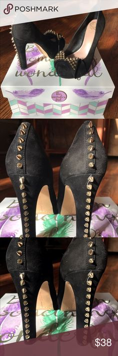 Vince Camuto Black Suede and Gold Spiked Heels One spike missing. See picture. All the way at the bottom. One spike was glued back on (first one just below seam on same shoe with missing spike). I bought this way and was unable to get them returned as they were then discontinued and sold out of my size. Cool shoes. Worn handful of times. Too tall for me now. Vince Camuto Shoes Heels