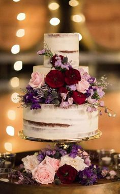 Featured Photography: Kaier Tan Photography; Chic three tier wedding cake accented with purple, red and pink flowers