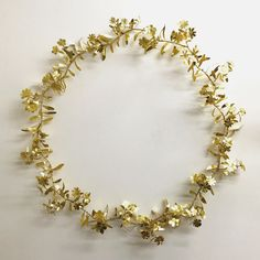 Floral wreath hand cut brass