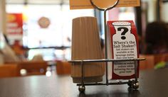 As Restaurants Cut Salt, Some See Reasons to Pass - It was a slightly curious gesture: last week, Boston Market, the national chain of rotisserie chicken restaurants, removed the salt shakers from its tables, replacing them with small placards — tucked next to the pepper shakers — promoting the company's interest in reducing sodium.