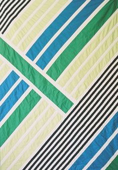 Fun modern geometrical quilt by Leslie Krout of the Good Report.