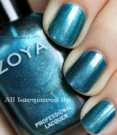ZOYA Holiday 2011: Zoya Noel is a moody blue that made me immediately think of Zoya Crystal from the Holiday/Winter 2010 Flame collection. Outside of the finish differences and the gold flakes, Crystal's base is a little more icy than Noel but they are definitely in the same denim blue color family.