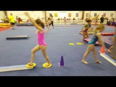 Learn forward roll exercises and how to instruct preschool gymnastics classes, including tumbling and basic gymnastic exercises for young children, in this f. Gymnastics For Beginners, Gymnastics At Home, Gymnastics Levels, Gymnastics Lessons, Gymnastics Academy, Preschool Gymnastics, Gymnastics Floor, Tumbling Gymnastics, Gymnastics Coaching