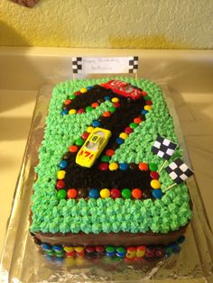 Easy DIY cars birthday cake for boys. Use M&Ms and crushed Oreos. …