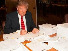 Donald Trump signing his huge federal tax return last October. It was three state returns, however, shed light on how he may have avoided paying federal taxes for 18 years.