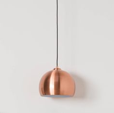 This small retro-look pendant lamp won't fail to give your interior that seventies feel. Chic, elegant and extremely versatile it fits in any room. The copper coloured finish on this ceiling light blends effortlessly into any modern home, great in the lounge or even the bedroom. This is the first to be marketed in the UK by Cuckooland and is delivered from Europe. Complete with a black cord and a stunning metal canopy. Maximum 60 watt bulb.- Copper coloured metal shade, metal canopySize…