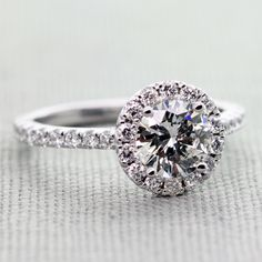 1.06 Carat, Round Diamond, H Color, VS1 Clarity, Very Good Cut, GIA, in a Diamond Crown Halo Engagement Ring in White Gold (3/4 Carats tdw.)