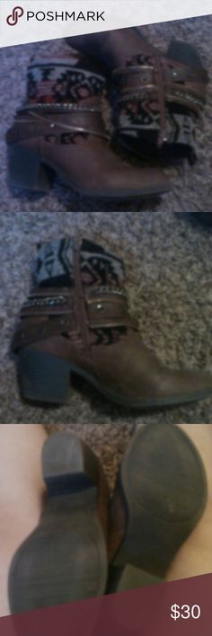 Low heeled cowboy booties. Cowboy print, and brown. One inch heel. Zipper on the inside. Size seven and a half. But fit more like an eight. Very comfortable and easy to walk in. It adds that little touch of girly Anny outfit. Great condition. I had hip surgery and my feet grew before I could wear heels again. Twister Shoes Ankle Boots & Booties