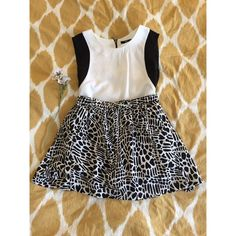 Animal print Urban Outfitters miniskirt Black and white animal print miniskirt with small pockets. Worn once, in perfect condition. Measures 14 inches long. Urban Outfitters Skirts Mini