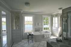 Suzie: Peter Zimmerman Architects - Waterfront master bathroom with gray paint color, built-in ...