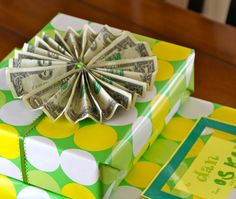 A bow made from six one-dollar-bills for a six-year-old's gift.  Fold each bill four times lengthwise, stack them, put a ribbon around them in the middle, and tape the ends together when you fan them out.