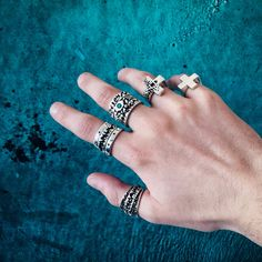 Luca Fersko wearing his stack of LucasPlus Jewelry. From left to right: Tapered Pixel Ring, Plus Band + Pixel Band Stack, Pixel Eye Ring Stack, Plus Ring Version 1, Classic Plus Ring
