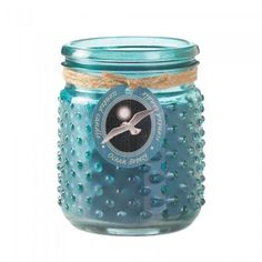 Welcome the crisp sea air into your room, no matter where you live! This delightful blue hobnail jar candle features a long-lasting candle that fills your space with the fresh scent of an ocean breeze. 16 oz and burns up to 100 hours.