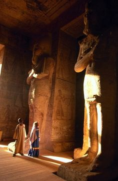 Visitors look tiny compared to these 9 meter-tall foot-tall) statues of Ramses II in his great temple at Abu Simbel. Egyptian Mythology, Ancient Egyptian Art, Ancient Ruins, Ancient History, Ancient Civilizations, Gods And Goddesses, Belle Photo, Archaeology, Statue