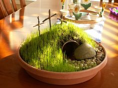 {EASTER}  Plant an Easter Garden!  Using potting soil, a tiny buried flower pot for the tomb, shade grass seed, and crosses we made from twigs.  Sprinkle grass seed generously on top of dirt, keep moistened using a spray water bottle.  Spritz it several times a day. Set it in a warm sunny location.  Sprouts in 7-10 days.