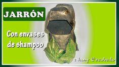 JARRÓN CON ENVASES DE SHAMPOO