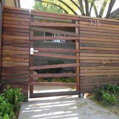 modern fence and gate - I like the fence, but the gate would NOT keep the dogs in!