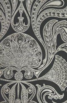 Malabar Wallpaper Black wallpaper with large metallic silver Paisley design in white.