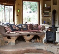 Cob House Interior... sort of what i want for the bathroom. a place to towel off by the fire :)