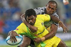 Shannon Walker of Australia is tackled during the rugby match between Australia and Fiji on Day One of the 2012 Gold Coast Sevens at Skilled Park in Gold Coast, Australia.