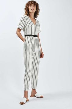 Revamp the basic jumpsuit with this tapered style. Crafted with a plunging v-neckline, this style comes detailed with a cropped and tapered trouser leg, and is cinched at the waistline with a grosgrain belt. #Topshop