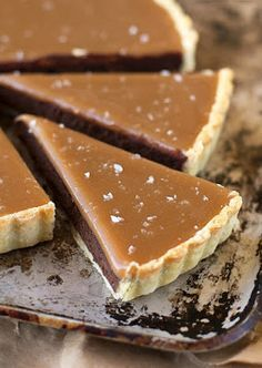 You won't be able to resist this salted caramel bittersweet chocolate tart! It's so incredibly smooth and rich- and of course, topped with homemade salted caramel! Salted Caramel Bittersweet Chocolate Tart - Life Made Simple Christina Chris Tart Recipes, Sweet Recipes, Baking Recipes, Dessert Recipes, Baking Ideas, Just Desserts, Delicious Desserts, Yummy Food, Think Food