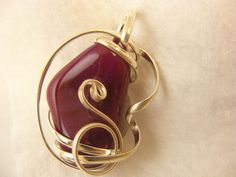 Dark Pink Agate with pendant wire wrapped.  Beautiful!