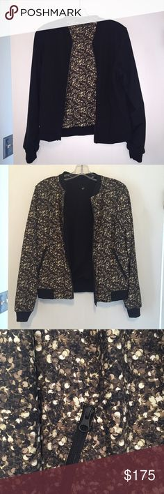 Lululemon athletica party bomb jacket Lululemon athletica party bomb jacket. Reversible jacket. Sequins print (not actual sequins -- so can be washed easily without damage) on one side and black on the other side. Bomber jacket style. Mid-weight. Perfect for fall. Size 4. Like new. lululemon athletica Jackets & Coats
