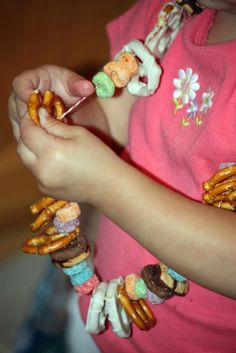 Make jewelry out of treats. Great for watching movies or going to the park. The kids will love making them and eating them!