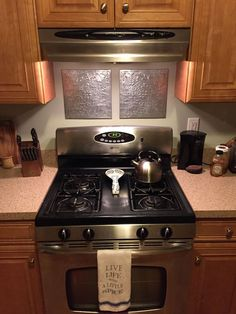 Using metal wall hangings for a quick backsplash stand-in.  This is even better than a backsplash!