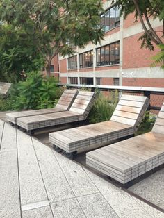 Cool sliding recycled wood deck chairs on the High Line NYC