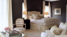 White bedding, curtains, carpet, and slipcovers keep the room from feeling too cavelike. A 19th-century French armchair is covered in Rogers & Goffigon's Olivia stripe in Argent and off-white. Alabaster lamps from Visual Comfort are on Oly Studio Jackson tables in Dark Brown.   - HouseBeautiful.com