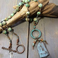 Serenity | Raspberry Fields Design Beautiful African turquoise beads with matte finish are hand knotted on this long Buddha pendant necklace.  Solid copper connector with gorgeous patina from Mykonos.  http://raspberryfieldsdesign.indiemade.com/product/serenity