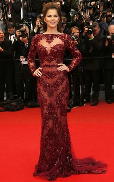 Cheryl Cole graced the red carpet in Cannes wearing a burgundy Zuhair Murad gown.