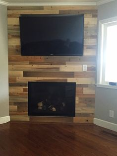 Our wall planks are made from perfectly-preserved timber that sank to the bed of the Penobscot River more than a century ago. Now you can give any room the look of modern, rustic elegance knowing there's a rich story behind it. Corner Fireplace Tv Stand, Pallet Fireplace, Corner Electric Fireplace, Wall Mounted Fireplace, Basement Fireplace, Brick Fireplace Makeover, Fireplace Built Ins, Home Fireplace, Fireplace Design