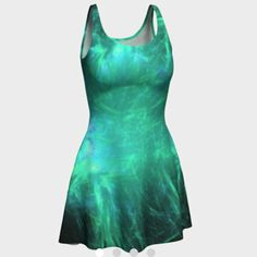 See in the summer weather with this delightful pretty flare dress in shades of green and a little touch of blue.